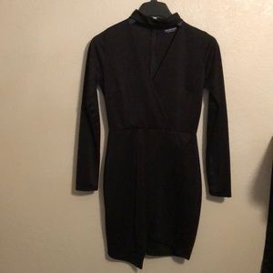 Woman's long sleeve, asymmetrical mini dress